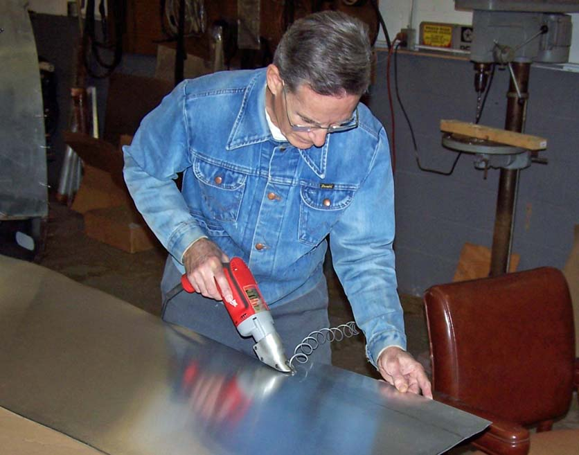 Pete cutting aluminum panel. Click on the picture to enlarge it.