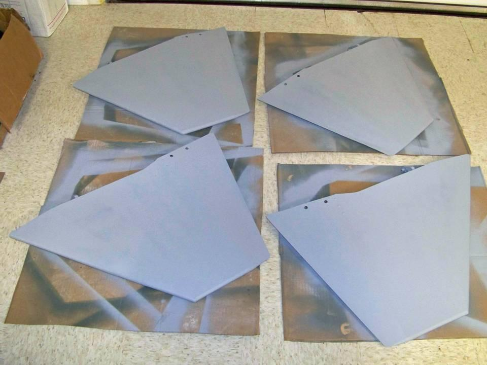 Picture of the 275-gallon fins in gray primer-filler color. 