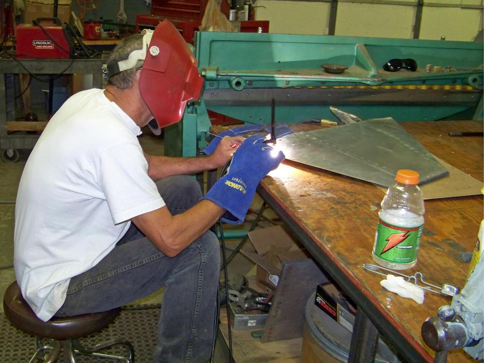 A picture of Steve Rettell welding a 275-gallon tank fin. 